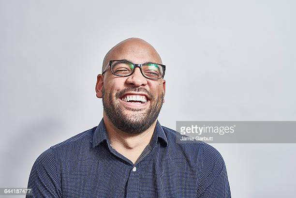 mixed race male laughing with his head back - lachen stockfoto's en -beelden