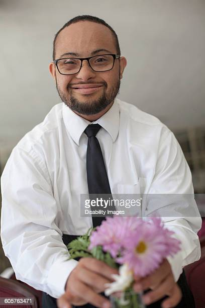 mixed race man arranging flowers - somerville massachusetts stock pictures, royalty-free photos & images