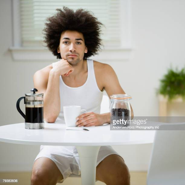 mixed race man having coffee - shorts stock pictures, royalty-free photos & images