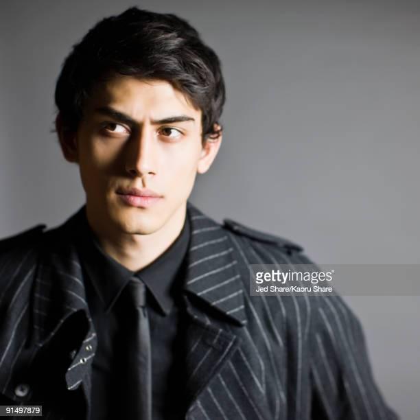 Mixed race man in fashionable coat