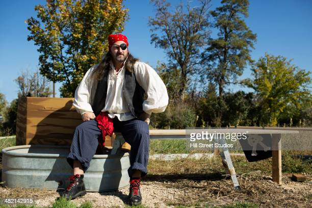 Mixed race man in pirate costume outdoors