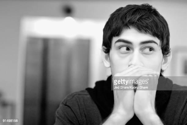Mixed race man looking anxious