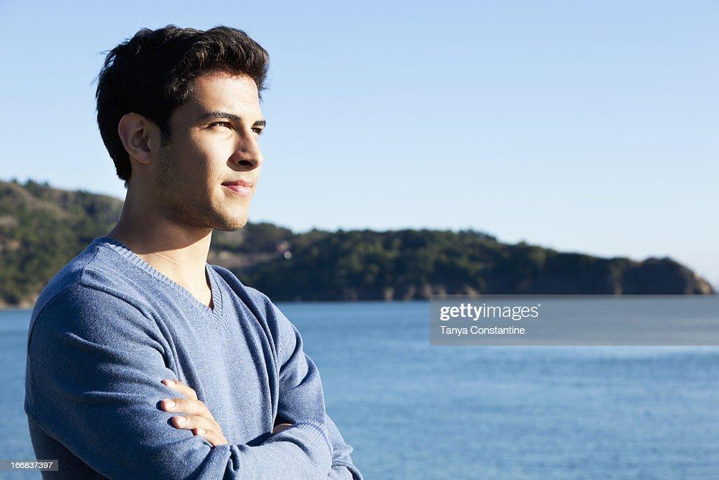 Mixed race man overlooking waterfront : Stock Photo