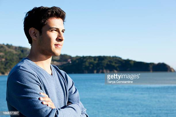 Mixed race man overlooking waterfront