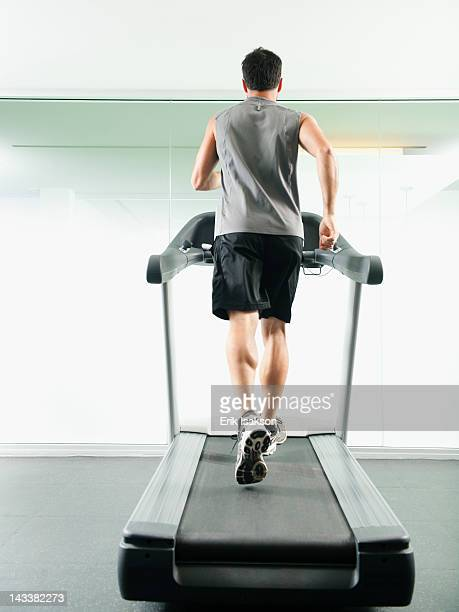 Mixed race man running on treadmill