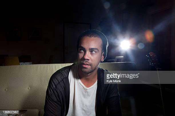 mixed race man sitting in nightclub - las américas fotografías e imágenes de stock