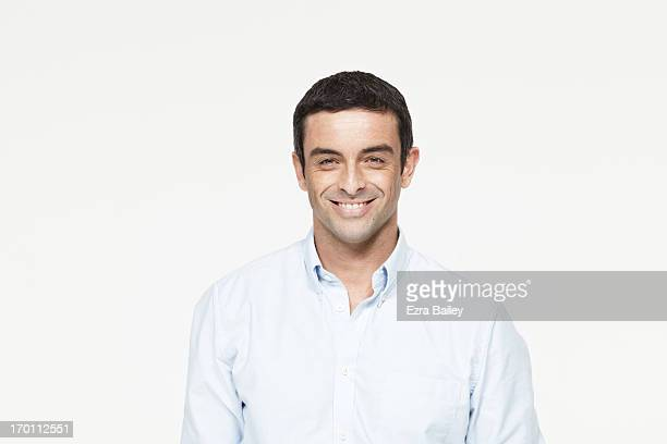 mixed race man smiling. - button down shirt stock pictures, royalty-free photos & images