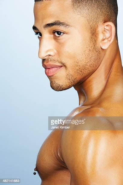 mixed race man smiling - brustwarzen piercing stock-fotos und bilder