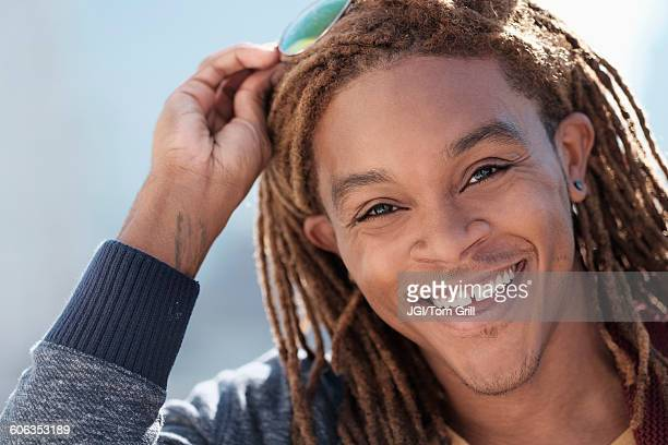 Mixed race man smiling