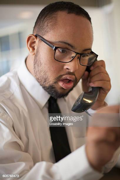mixed race man talking on telephone - somerville massachusetts stock pictures, royalty-free photos & images