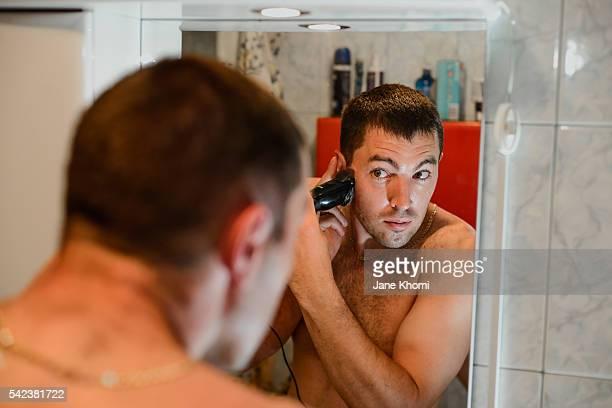 DIY: Mixed race man trimming his hair