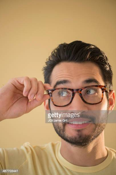 Mixed race man wearing glasses