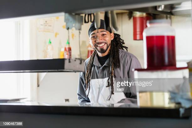 mixed race man with dreadlocks in commercial kitchen - do rag stock pictures, royalty-free photos & images