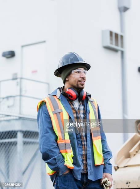 Mixed race man working at shipping port