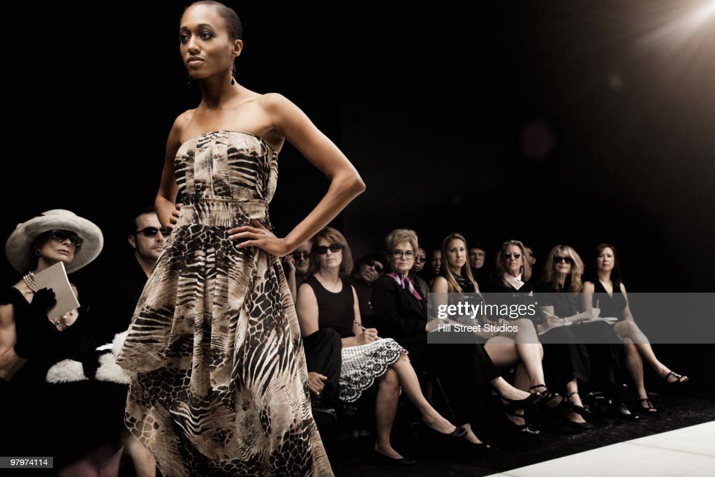Mixed race model on runway in fashion show : Stock Photo