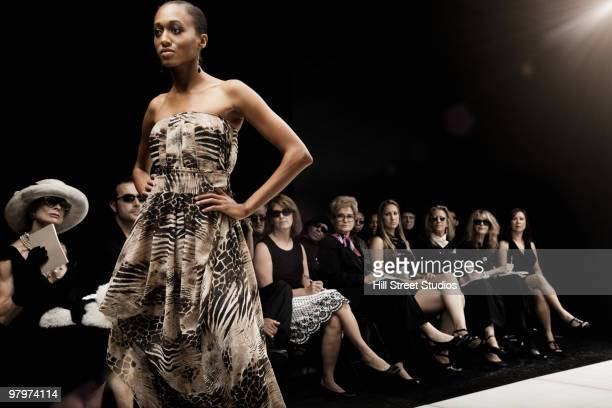 mixed race model on runway in fashion show - fashion show stock pictures, royalty-free photos & images