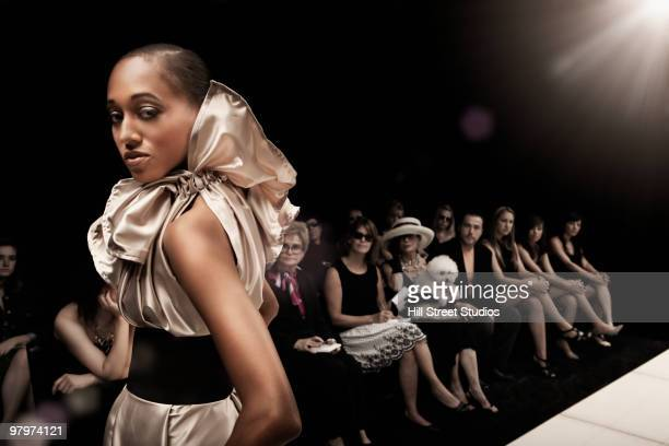Mixed race model on runway in fashion show