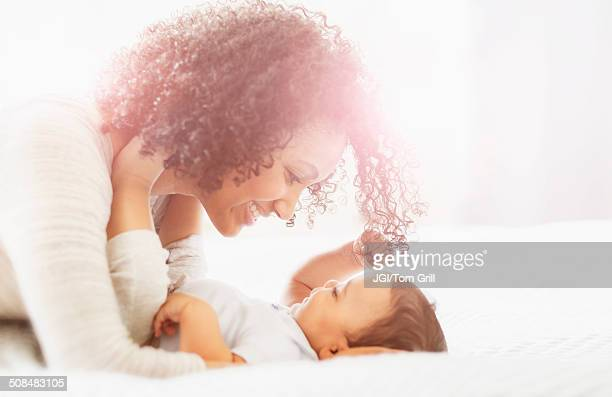 Mixed race mother admiring baby