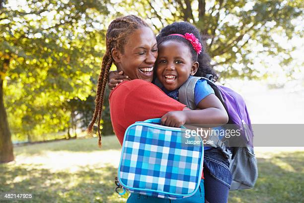 Mixed race mother and hugging daughter