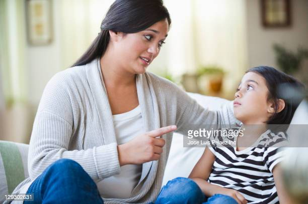 mixed race mother lecturing daughter - mother scolding stock pictures, royalty-free photos & images