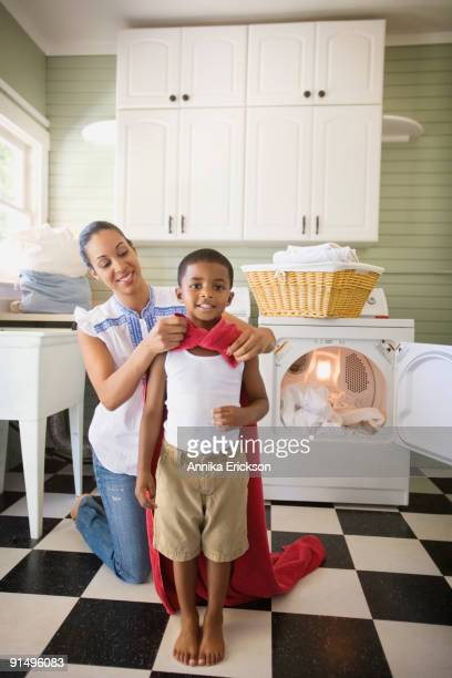 Mixed race mother tying towel to son