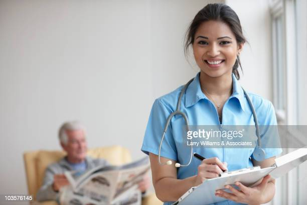 Mixed race nurse caring for patient