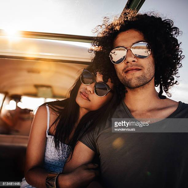 Mixed Race Person Hipster Friends Sitting at Sunset in van