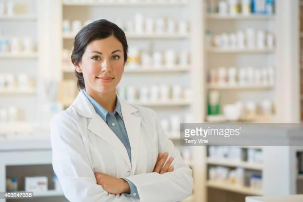 Mixed race pharmacist in pharmacy