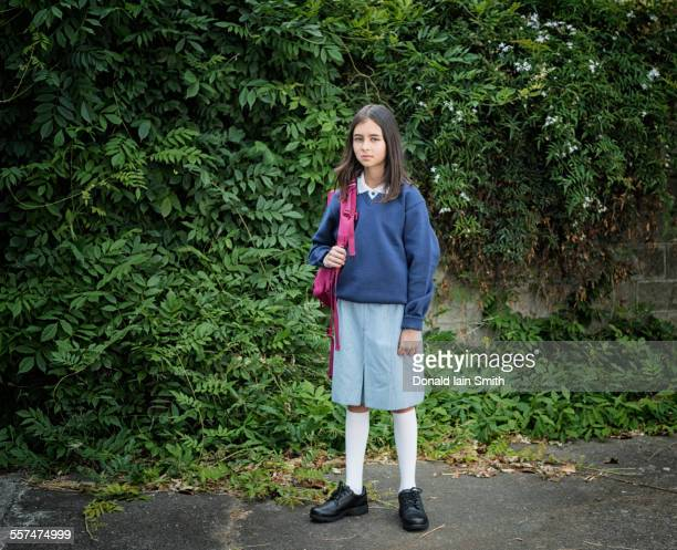 mixed race schoolgirl in uniform with backpack - palmerston north new zealand stock pictures, royalty-free photos & images