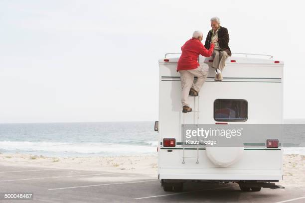 Mixed race Senior couple sitting on RV