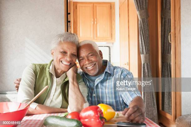 Mixed race Senior couple smiling in RV
