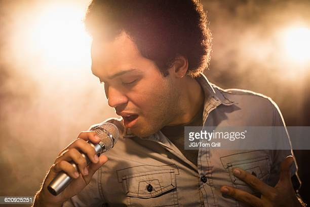 mixed race singer performing on stage - gospel stock photos and pictures