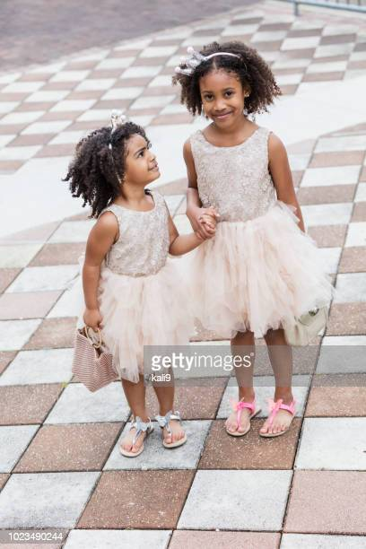 mixed race sisters wearing princess dresses and tiaras - crown close up stock pictures, royalty-free photos & images