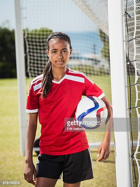 Mixed race soccer player standing in goal