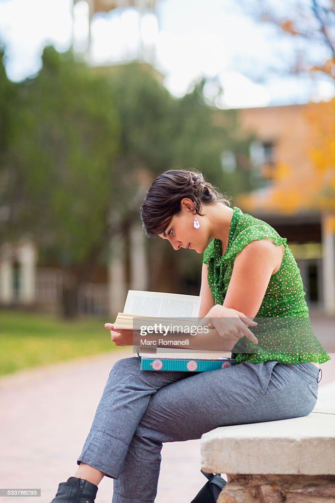 Mixed race student studying on campus : Foto stock