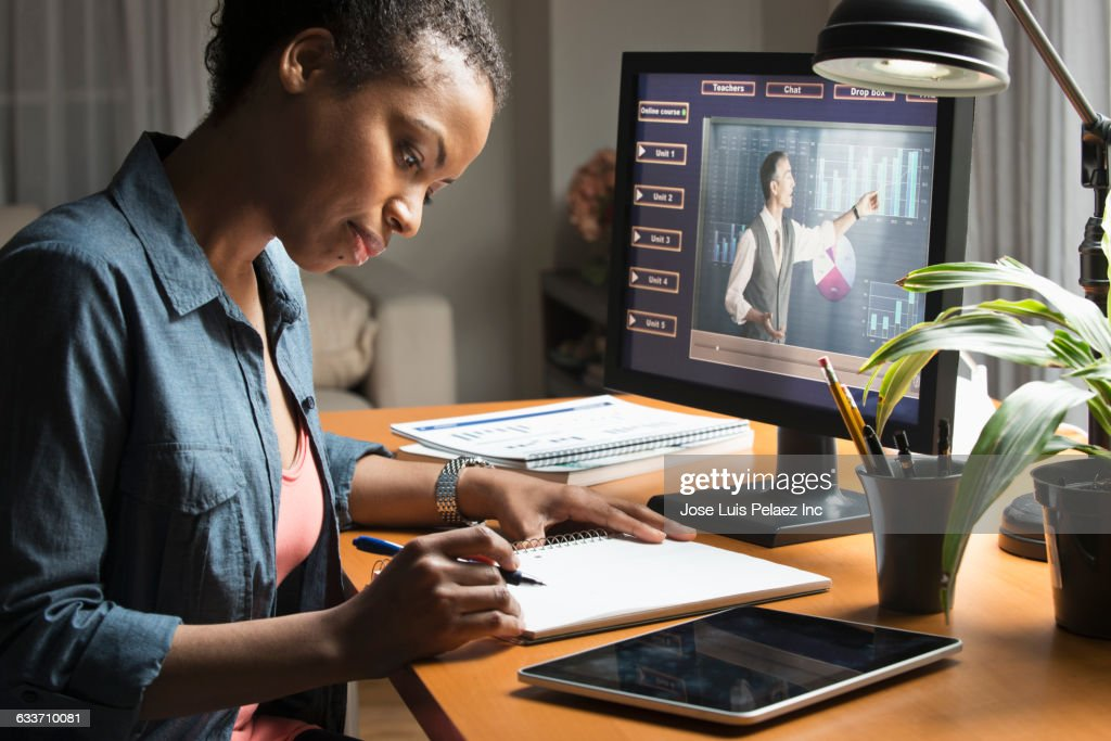 Mixed race student taking online class on computer : Stock Photo