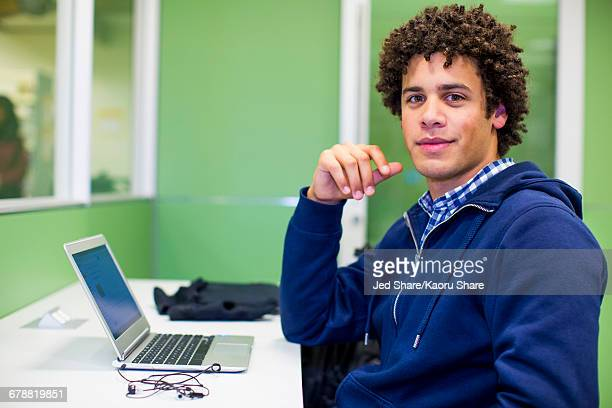 Mixed Race student using laptop in library
