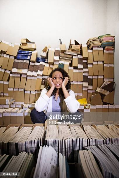 mixed race student working in archive - tensed idaho stock photos and pictures