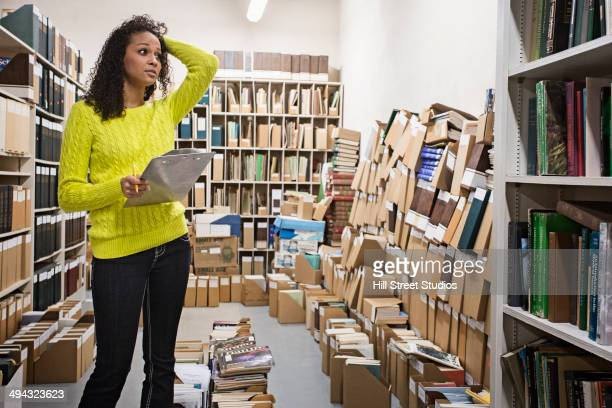 mixed race student working in library - tensed idaho stock photos and pictures