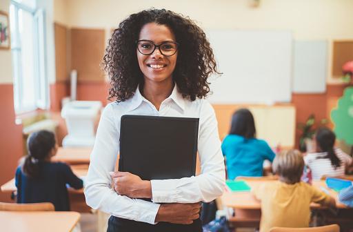 Mixed race teacher in the classroom 1043554794
