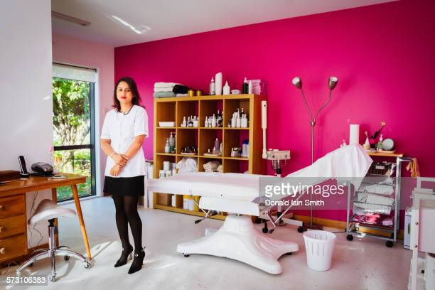 Mixed race technician working in home beauty parlor