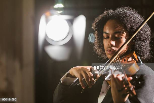 mixed race teenage boy playing the violin - performing arts event stock pictures, royalty-free photos & images
