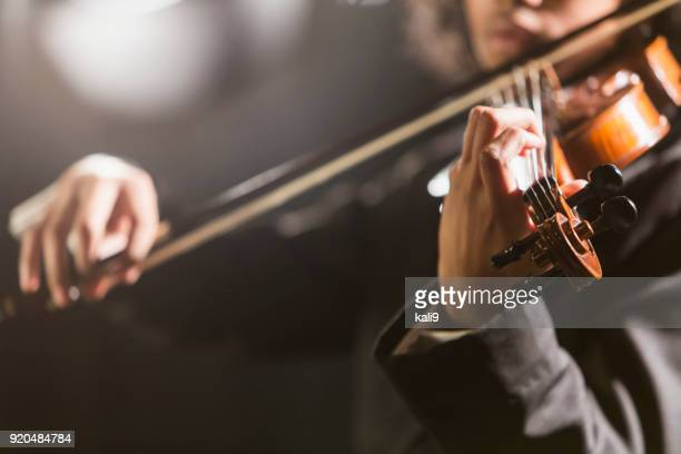 mixed race teenage boy playing the violin - classical stock pictures, royalty-free photos & images