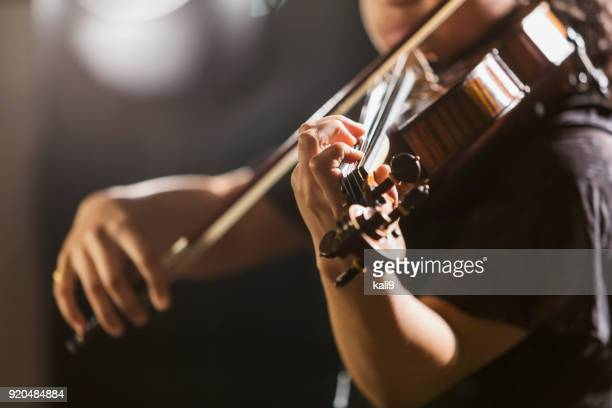 mixed race teenage girl playing the violin - stringed instrument stock pictures, royalty-free photos & images