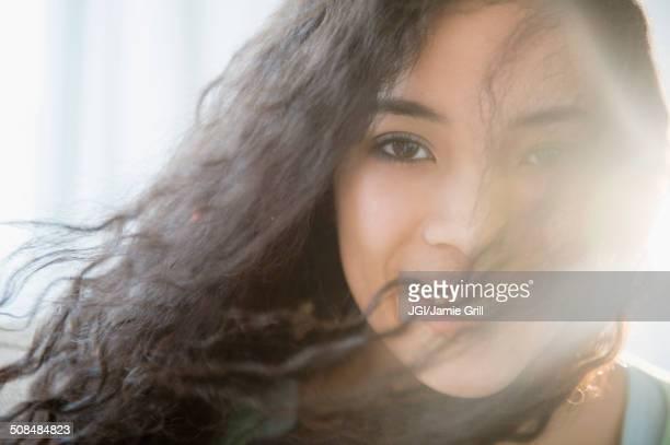 Mixed race teenage girl smiling