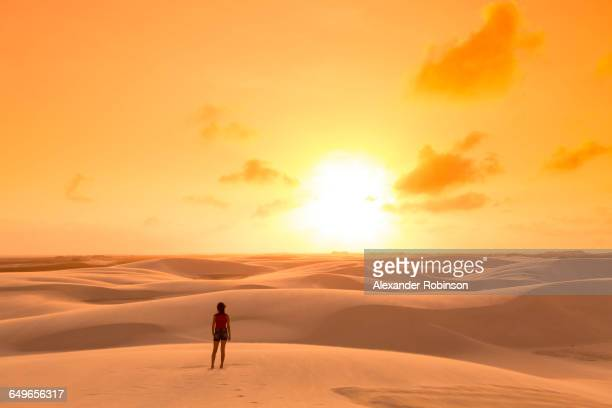 Mixed race teenage girl standing in remote desert