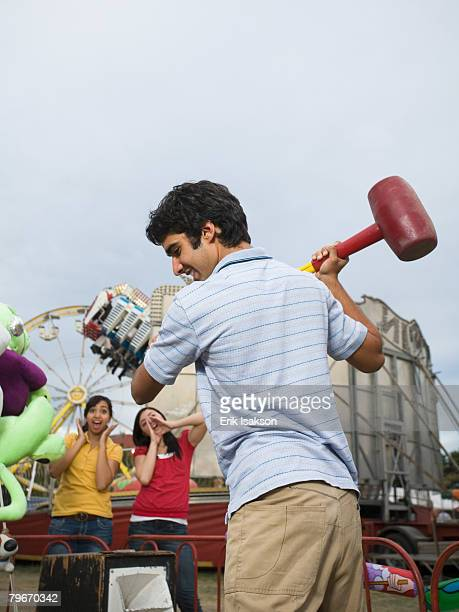 Mixed Race teenaged boy playing carnival game