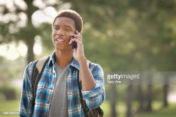 Mixed race teenager talking on cell phone