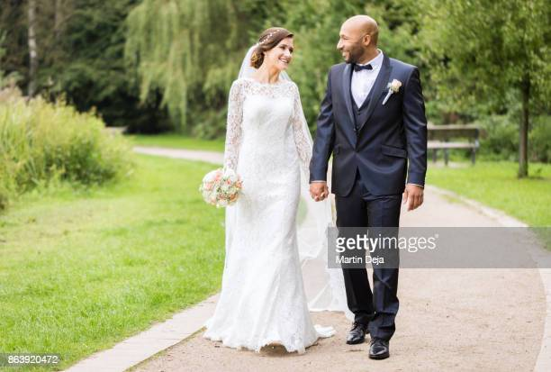 mixed race wedding - groom stock pictures, royalty-free photos & images