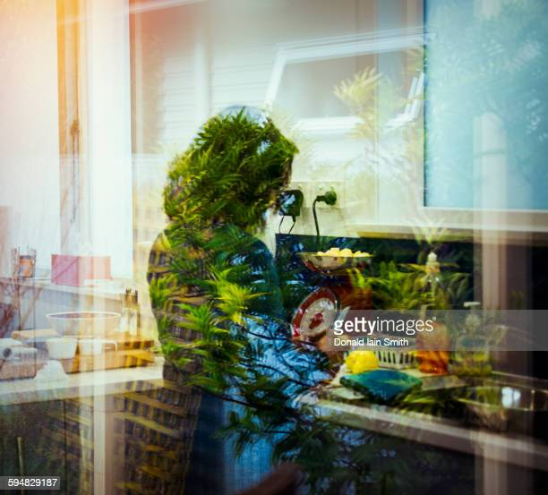 Mixed race woman behind window reflections